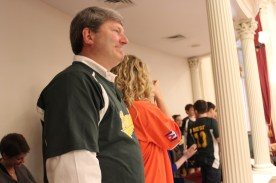 Coach Tom Simon looks on proudly while his team is congratulated at the state house.