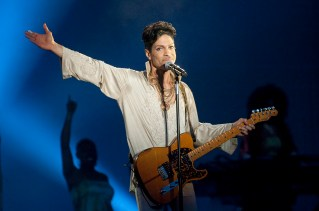 PADDOCK WOOD, UNITED KINGDOM - JULY 03: Prince headlines the main stage on the last day of Hop Farm Festival on July 3, 2011 in Paddock Wood, United Kingdom. (Photo by Neil Lupin/Redferns)