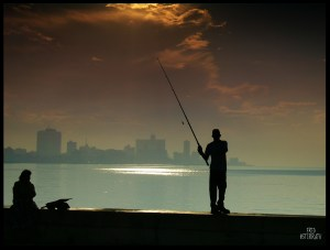 Cuban Fishing, 3-7-15, Pescador en el malecon By Fredo_photo Via Creative Commons.