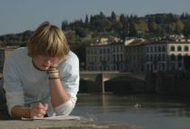 italy-florence-by-middlebury-student-reading-on-bridge