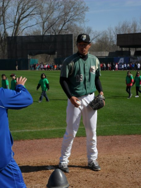 Jen-Ho Tseng gets some instruction during his side session from Coach Rosario - Photo by Todd Johnson