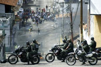 Students clash with national guards during a protest against the government in San Cristobal