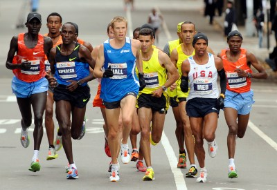 Americans Meb Keflezighi, second from right, and Ryan Hall, center, lead the New York City Marathon, Sunday, Nov. 1, 2009. Keflezighi won the race and Hall was fourth. Kenya's Robert Cheruiyot, left, was second. (AP Photo/Henny Ray Abrams)