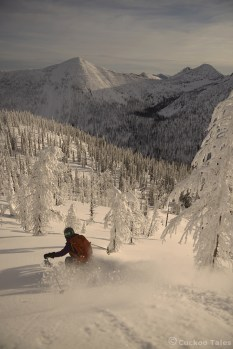 Skiing down White Queen with Larch in view.