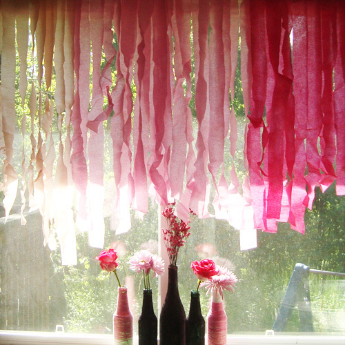 about to pop baby shower glitter bottles and crepe paper curtain