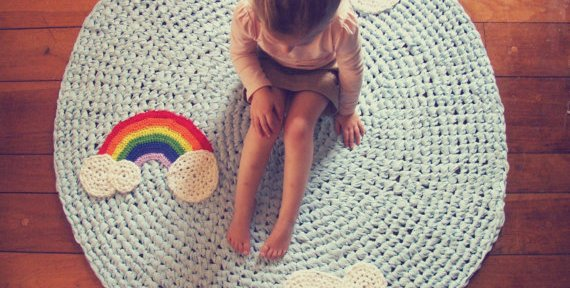 Momtreprenuer: King Soleil rainbow and clouds rug