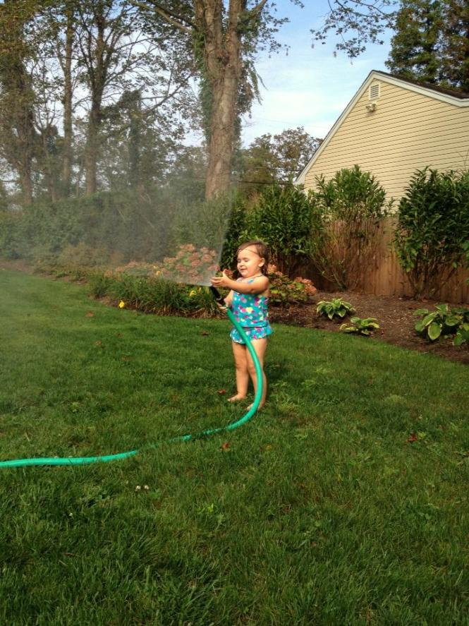 ellie with the hose