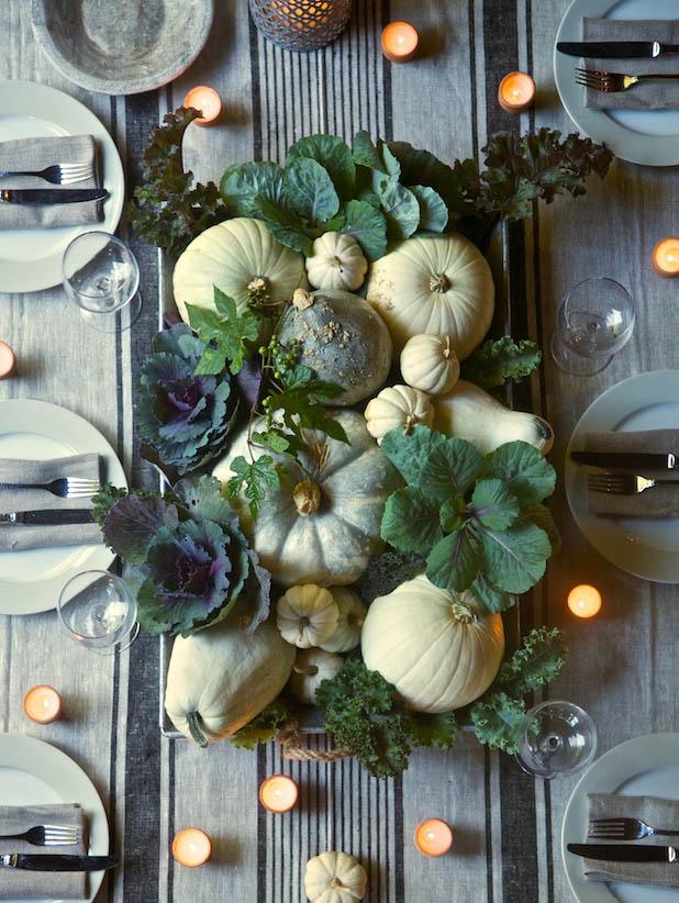 fall pumpkin decor: pumpkin centerpiece with greens
