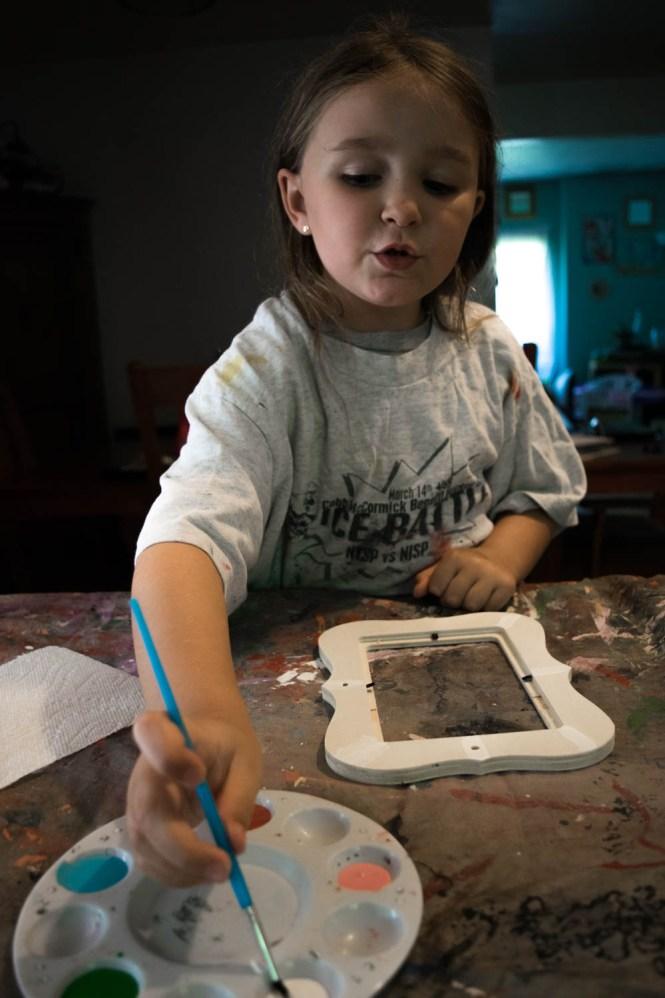 Wrangle Your Kids' Seashell Collection- painting DIY seashell frame
