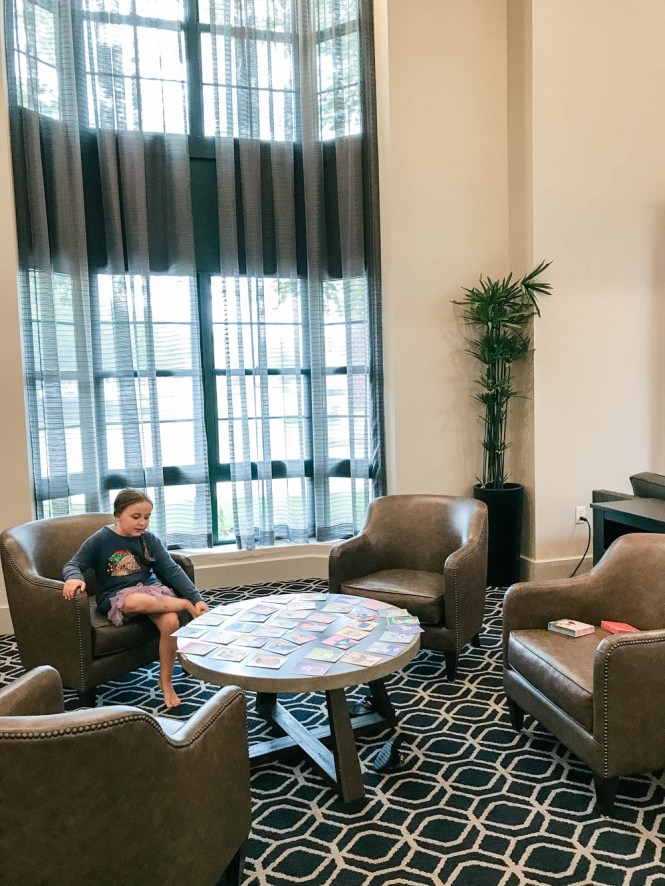 playing games in the Hilton Mystic lobby - family-friendly hotel in Mystic, Connecticut