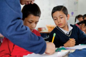 A teacher works with students in Mexico