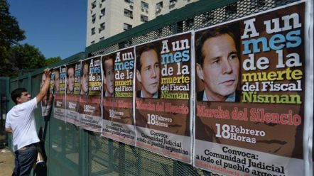 Posters advertise protest march in Argentina.