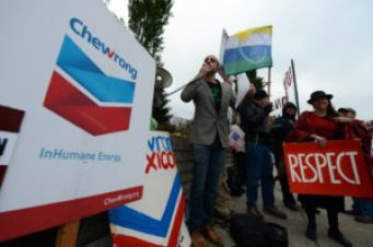 Adam Zuckerman of Amazon Watch leads the protest Wednesday against Chevron Oil in Ecuador oil pollution case.