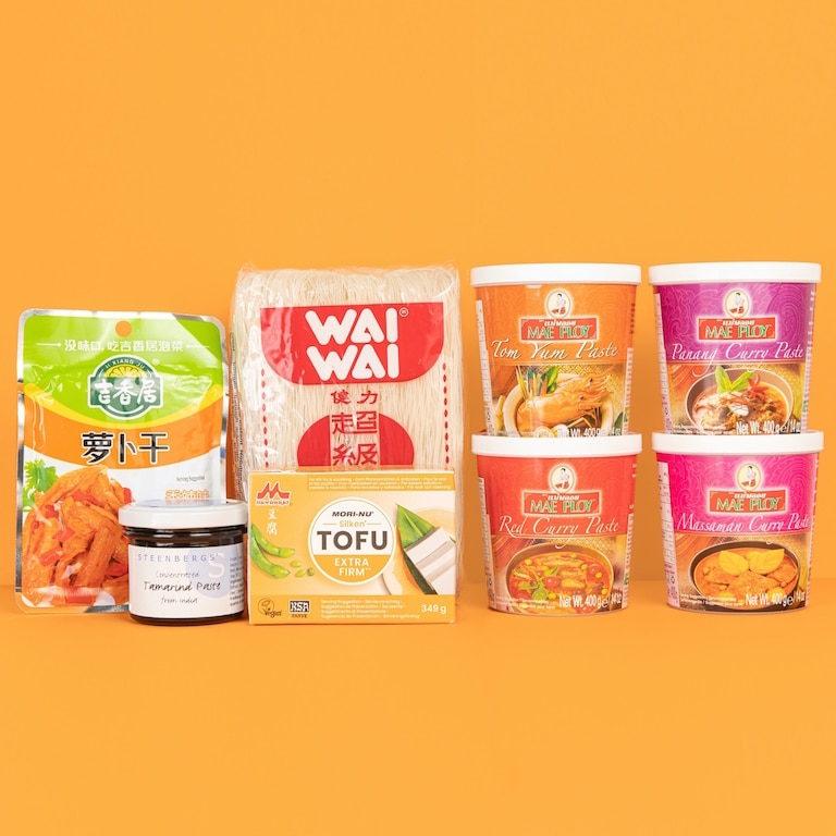 Thai Box content including: Red curry paste, Massaman curry paste, Tom Yum paste, Panang paste, Concentrated Tamarind paste, Vermicelli noodles, Extra firm Tofu and spicy dried Turnip.