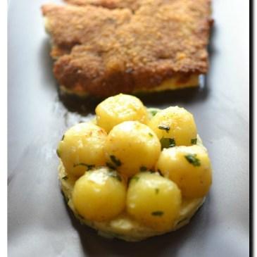 Dos de cabillaud en croûte de pesto rouge , écrasée et billes de pommes de terre