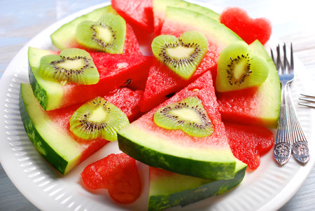 43895264 - fruit salad with heart shaped kiwi and watermelon on plate