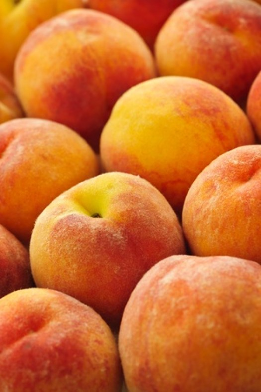 10708466 - ripe fresh peaches as background close up
