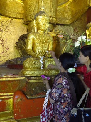 Ananda Temple, Bagan–offering Gold To Buddha
