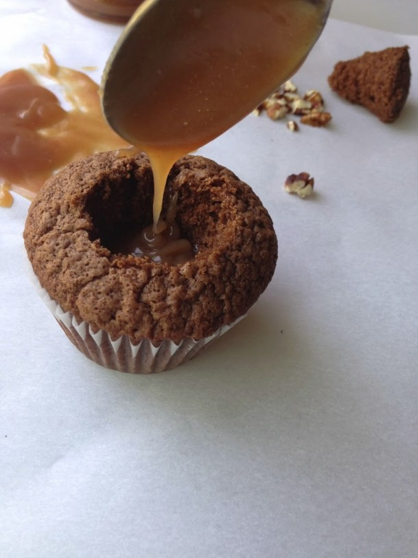 Chocolate caramel turtle cupcakes. Chocolate cupcakes filled with salted caramel sauce, topped with coffee frosting, toasted pecans and more salted caramel sauce.