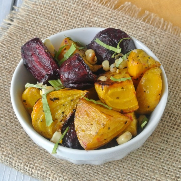 Roasted beet and grilled corn salad are a delicious use of seasonal vegetables for a summery, eye catching side dish.