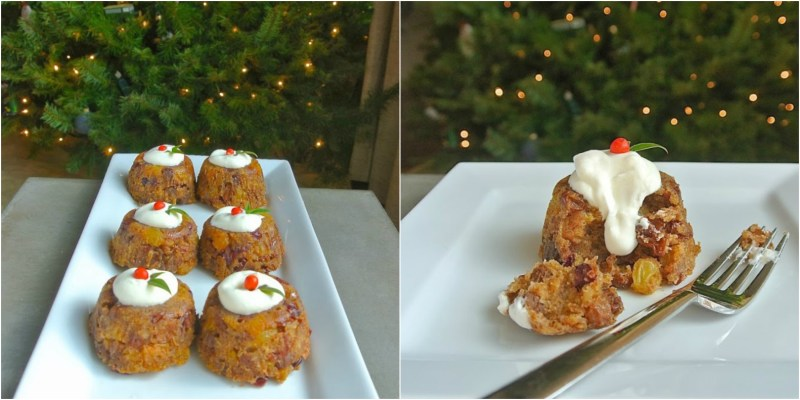 Small Christmas puddings lined up on a plate with a Christmas tree in background