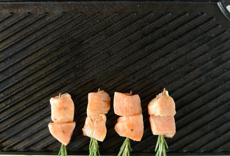 Rosemary skewered chicken on the grill