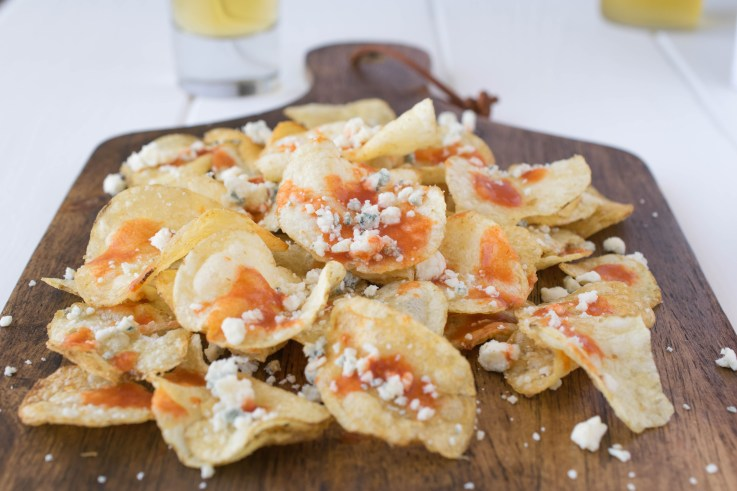 Hell's fire chips, an easy snack of potato chips, hot sauce and blue cheese.