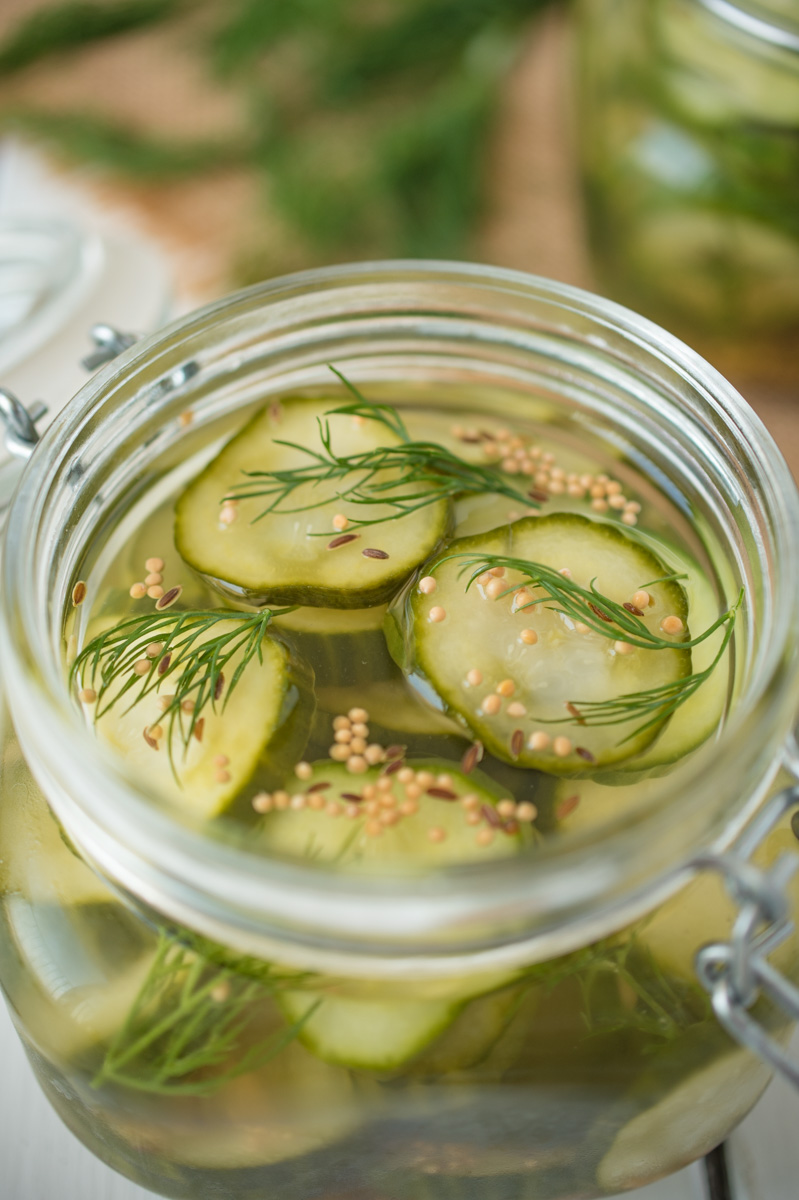 A closeup showing the cucumber slices, fresh dill and pickling spices