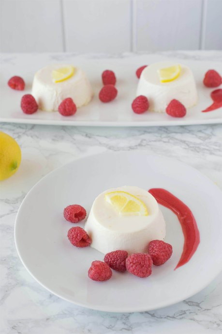 Lemon panna cotta with raspberry sauce. Creamy and sweet, this is an easy dessert that can be made ahead, refrigerated and served when you're ready for dessert.