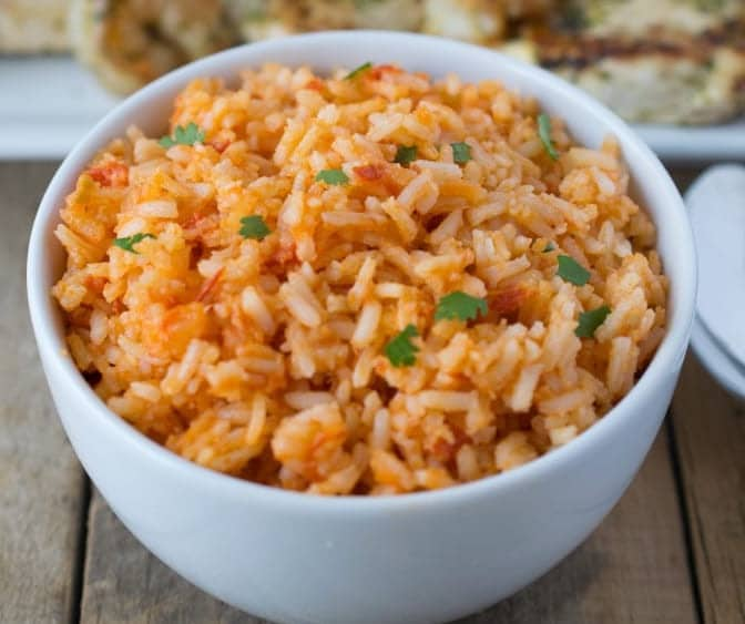 I love easy weeknight dinners that can be transformed into delicious leftover lunches. Mexican rice is not only a delicious side dish that is made in the traditional way,but makes great leftovers for lunches all week.