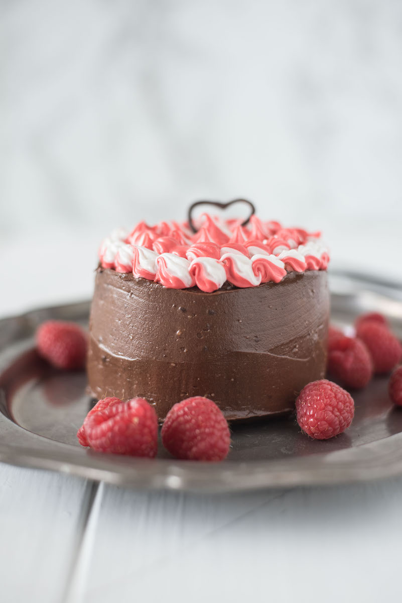 Mini chocolate cake for two is a chocolate lovers dream. Rich chocolate cake is smothered in gorgeous dark chocolate frosting with a little special decorating.