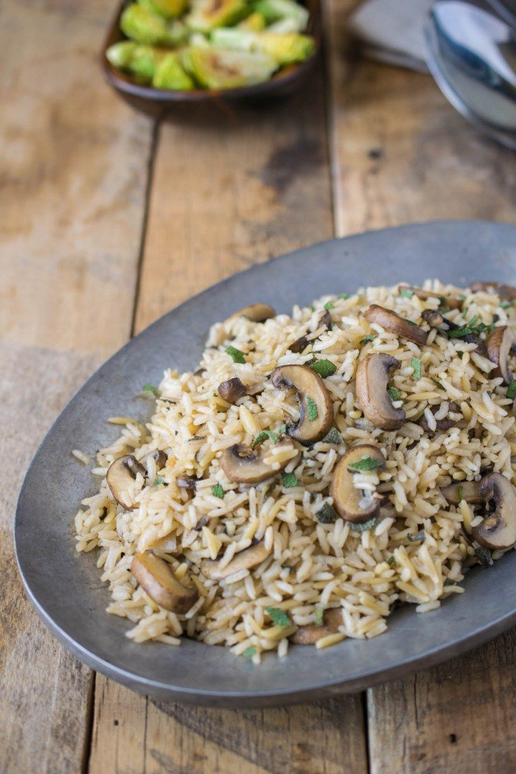 Mushroom and sage rice pilaf on a pewter plate