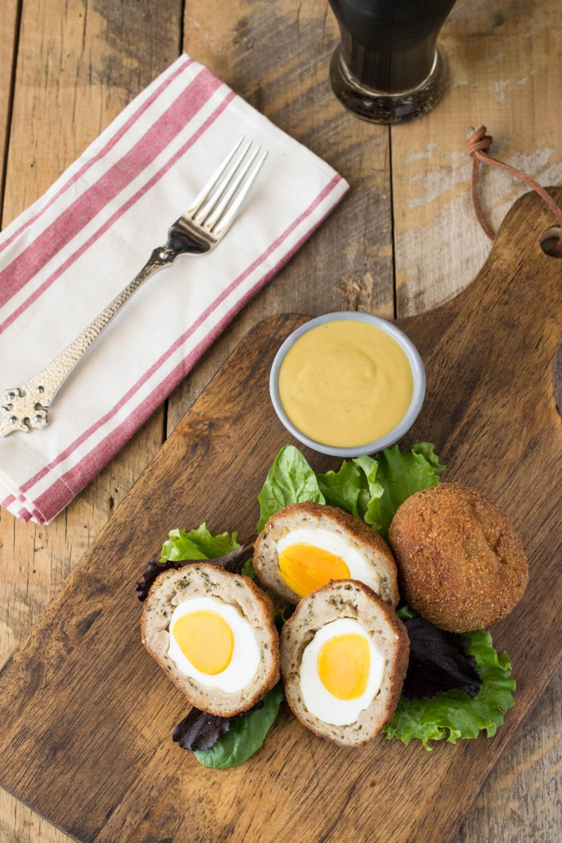 Scotch eggs are hard-boiled eggs wrapped in sausage meat, breaded and fried. Served with a delicious mustard dipping sauce, this is quintessential British fare.