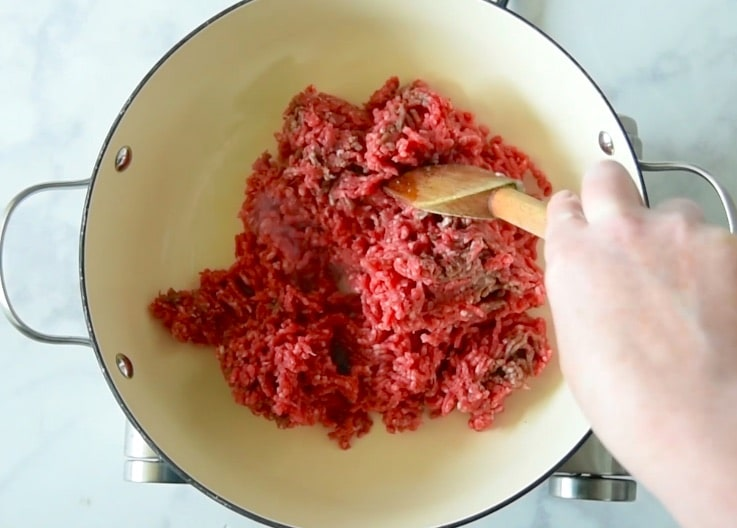 Ground beef is browned in a pan