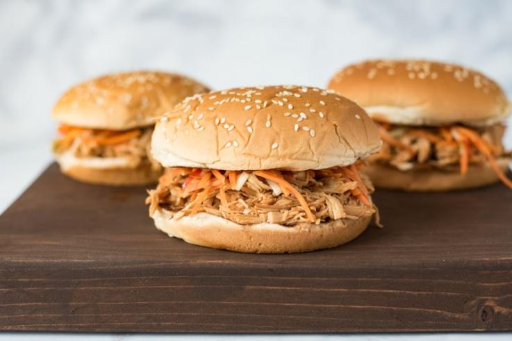Slow cooker Asian chicken sandwiches with pickled carrot slaw are a little sweet, a little salty, with a fresh, slightly spicy kick from the carrot slaw.