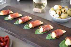 Smoked prosciutto wrapped apple bites are an easy and delicious warm appetizer that are perfect to serve with wine for entertaining. Sweet apples wrapped in Parmesan cheese, smoked prosciutto and basil served warm.