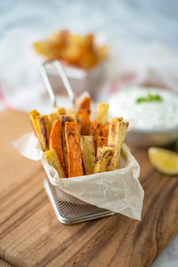 Sumac baked sweet potatoes with mint yogurt dip makes a great game day snack, appetizer or serve with breaded fish for a different take on fish & chips.