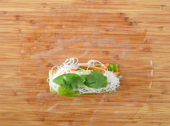 Fresh mint, basil and cilantro is added on top of the rice noodles