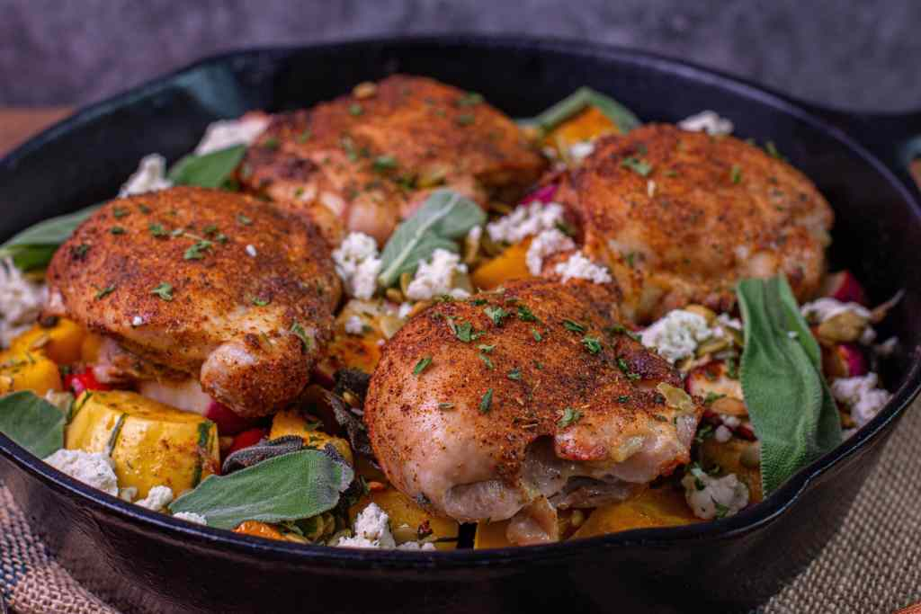 boneless chicken thighs in a cast iron pan with Boursin cheese and pepitas
