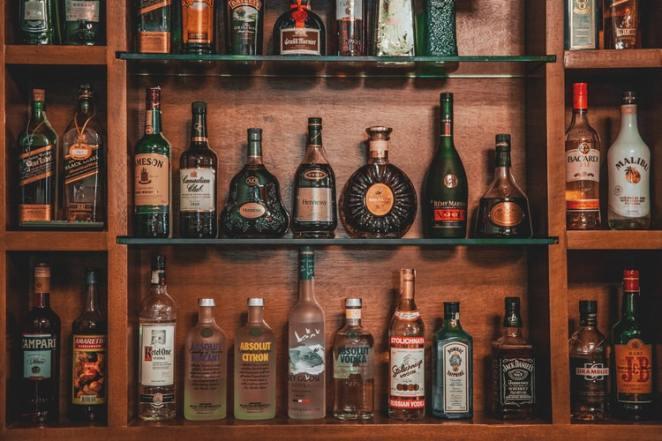 Liquor bottles stored on shelves
