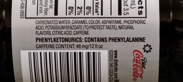 Phenylketonurics warning on bottle of Diet Coke.