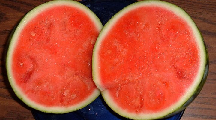 Seedless watermelon sliced in half to show flesh of fruit