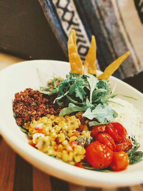 Healthy Latin Bowl with Red Quinoa, Guacamole, Florida Sweet Corn Salad, Roasted Tomatoes & Quesadilla Cheese