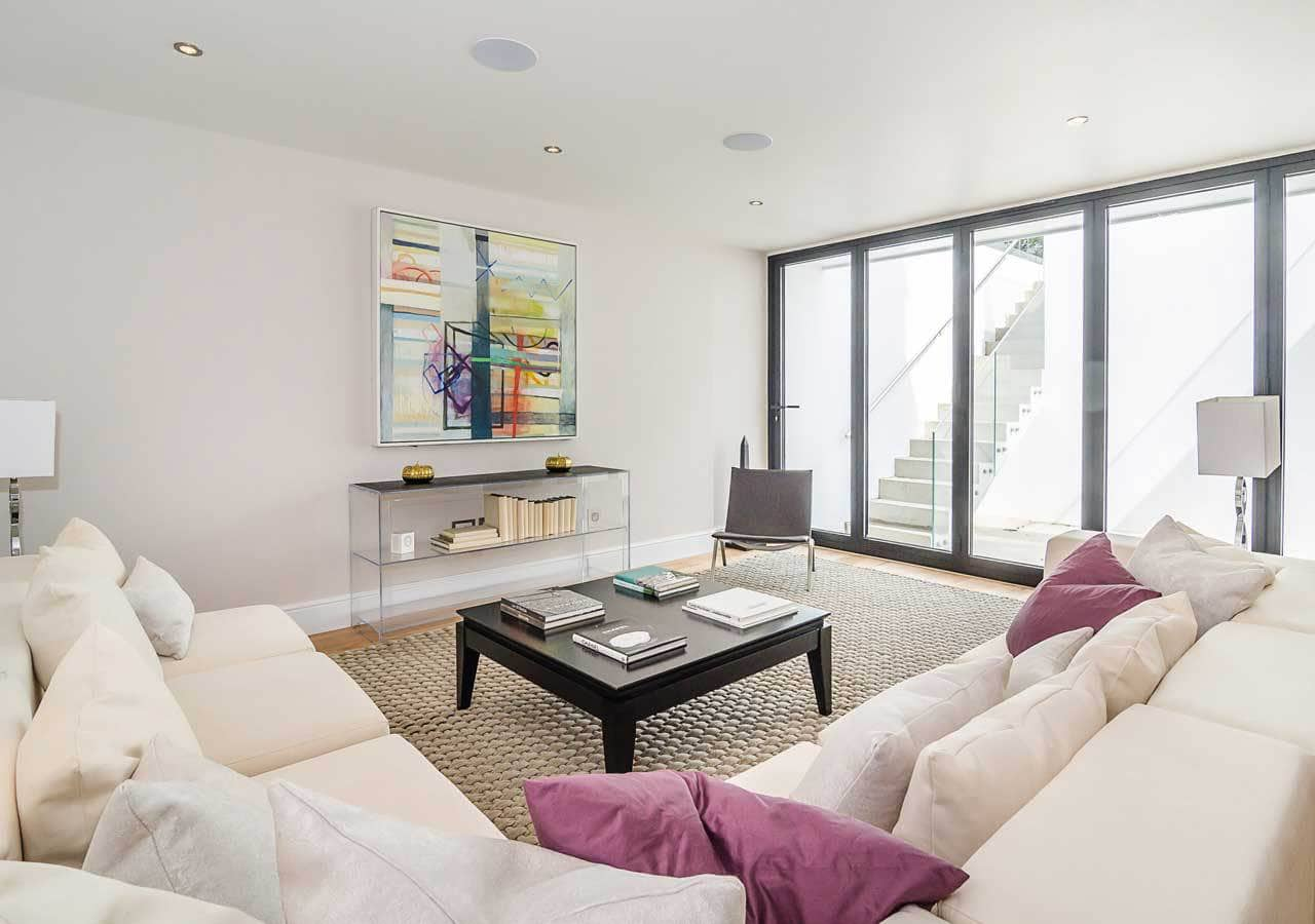 A classic contemporary basement media room home staged by Cullum Design | London UK