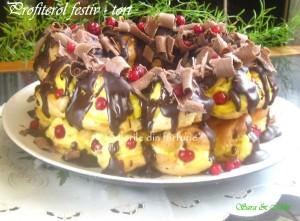 6. Profiterolul festiv gata decorat cu ciocolata.