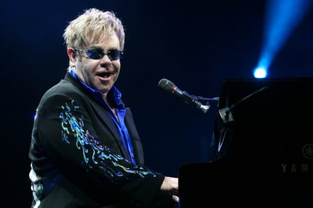 A photo of Elton John performing on stage.