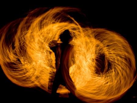 A man twirling fire.