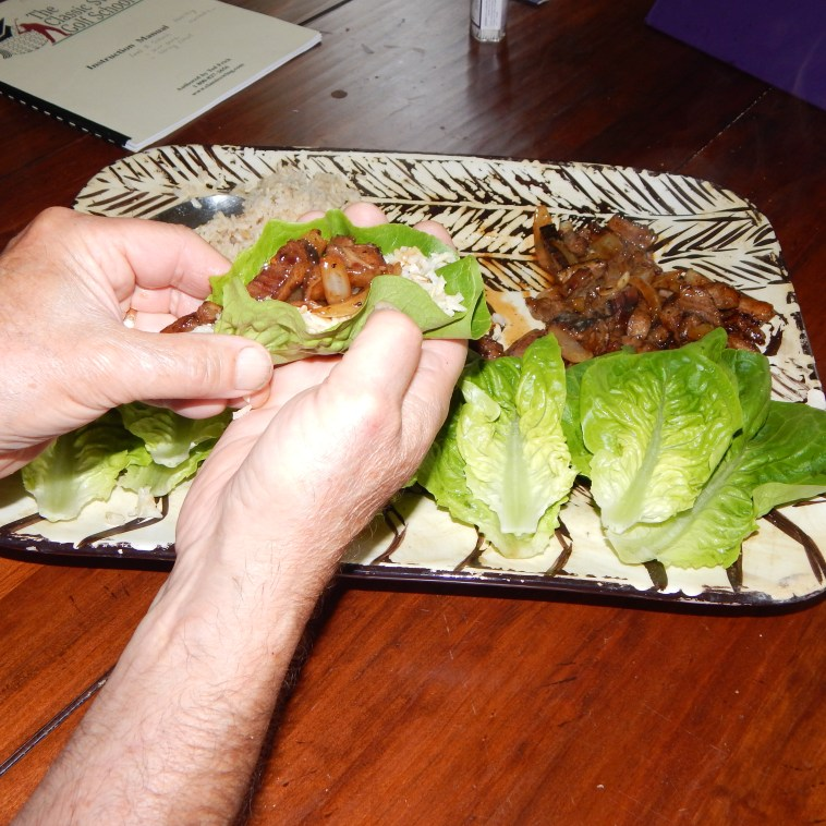 "LITTLE GEM LETTUCE BOAT WITH RICE AND LEFTOVER FLANK STEAK SAUTEED WITH ONIONS AND ""SAIGON SIZZLE"" SAUCE"