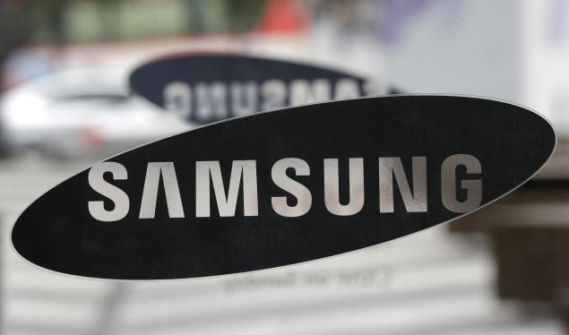 Samsung Electronics Co. logo is seen at a showroom of its headquarters in Seoul, South Korea, Friday, July 5, 2013. Even after setting a record high profit, Samsung Electronics disappointed investors who increasingly doubt its mainstay smartphone business can maintain rapid growth. (AP Photo/Lee Jin-man)