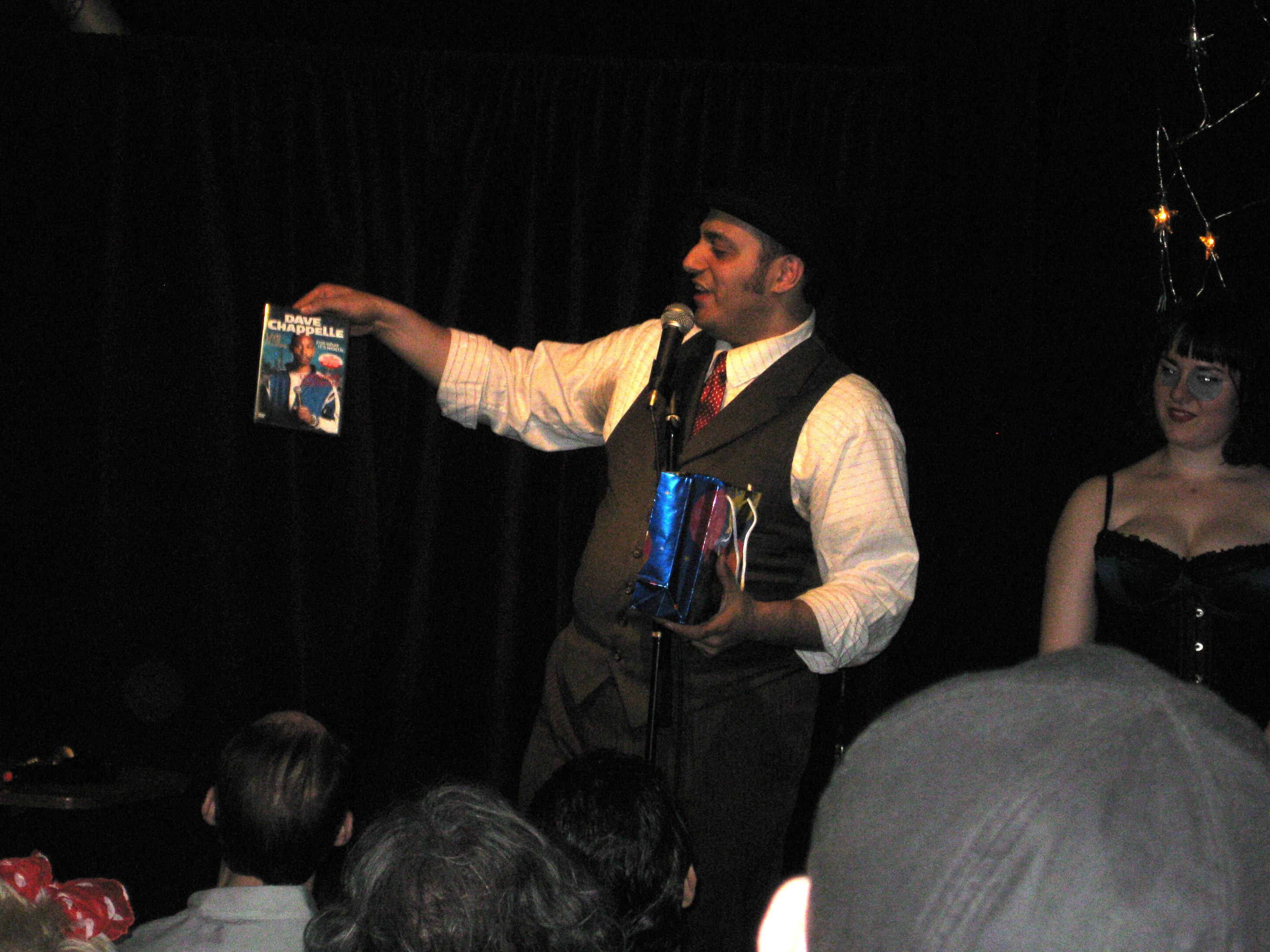 Nelson Lugo showing off a copy of Dave Chapelle Live at the Filmore